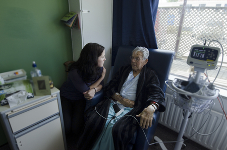 nursing assistant: Social worker visit sick old male patient in hospital. Stock Photo
