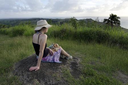 explores: Tourist woman explores the nature and landscape of Aitutaki Lagoon, Cook Islands Stock Photo