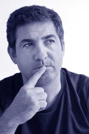 introspective: Mature man thinking with one finger on his lips looking away.close up on white background. real people. Concept photo of puzzled, confused, worried, problems, alone, thoughtful, worried, man (BW) Stock Photo