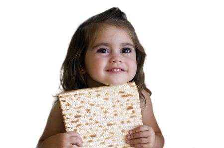 matzoh: Jewish girl eating a matzo in passover Jewsih holiday.