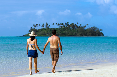 rarotonga: Attractive young happy couple on vacation on Muri beach lagoon in Rarotonga, Cook Islands.