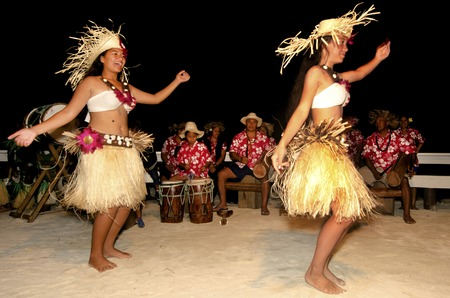 tahitian: Portrait of Polynesian Pacific Island Tahitian female dancer in colorful costume dancing on tropical beach.