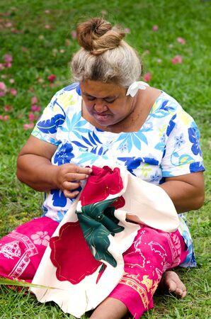 tahitian: Portrait of Polynesian Pacific Island Tahitian mature female sewing Tivaivai outside her home in Aitutaki lagoon Cook Islands. Stock Photo