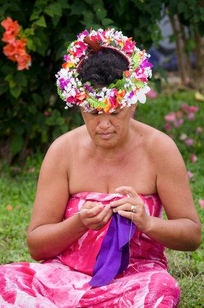 tahitian: Portrait of Polynesian Pacific Island Tahitian mature female sewing Tivaivai outside her home in Aitutaki lagoon Cook Islands. Editorial