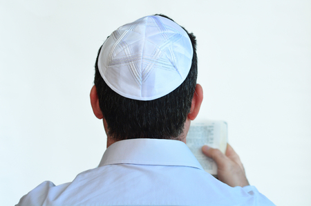kippah: Jewish man with kippah pray isolated on white background. Concept photo Judaism ,religion belief, faith, lifestyle