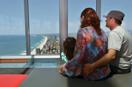 gold coast australia: Family looks at the view of Surfers Paradise from the Skypoint observation deck at the top of the Q1 on the Gold Coast, Australia. Stock Photo