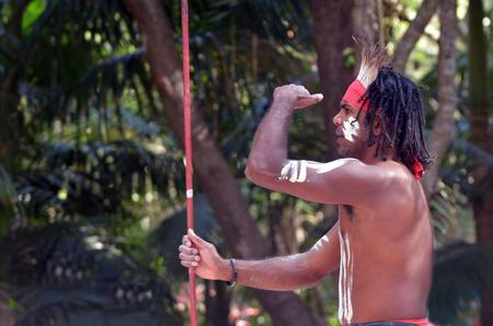 australian ethnicity: Portrait of one Yugambeh Aboriginal warrior man preform Aboriginal culture during cultural  show in Queensland, Australia. Stock Photo
