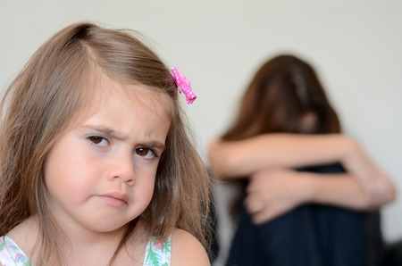 tantrum: Little girl (age 05) having a temper tantrum with her desperate mother in background
