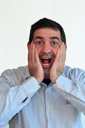 astonish: Man surprised face expression. Male emotional expression on white background. Concept photo of astonish,surprise, shock, wonder, amaze. Stock Photo