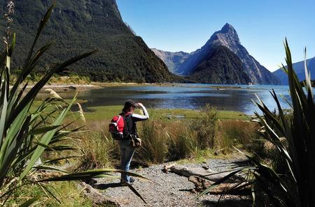 explores: A tourist explores Fiordland, southern New Zealand. Stock Photo