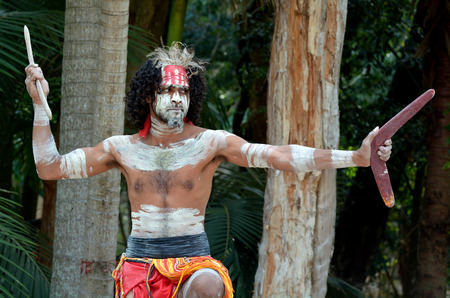 ethnography: Portrait of one Yugambeh Aboriginal warrior man preform Aboriginal culture martial art during cultural  show in Queensland, Australia.