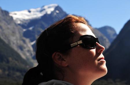 mitre: A tourist explores Fiordland, southern New Zealand. Stock Photo