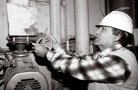 electrical system: Electrical engineer checking a electrical system .