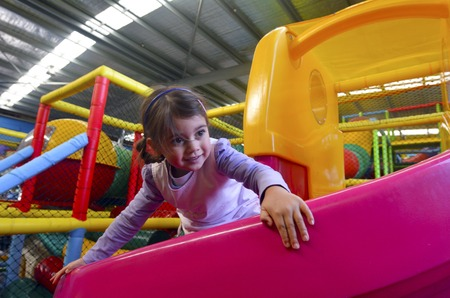 play of color: Little girl play in indoor playground.
