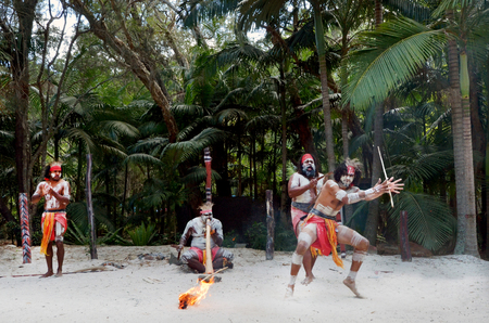 Group of Yugambeh Aboriginal warriors dance during Aboriginal culture show in Queensland, Australia.