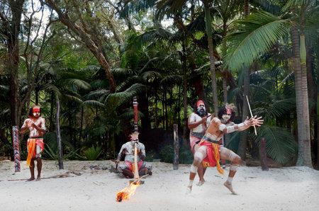 Group of Yugambeh Aboriginal warriors dance during Aboriginal culture show in Queensland, Australia.