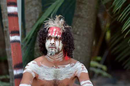 Portrait of one Yugambeh Aboriginal warrior man covered with body painting during Aboriginal culture during cultural  show in Queensland, Australia.