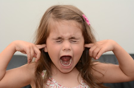Screaming child (girl age 05) face. concept photo of stress and anxiety. Stock Photo