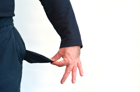 Lege zak van een man zonder geld op witte background.Concept foto van de werkloosheid, welzijn, schuld, depressie, wanhoop,