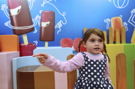 calories poor: Little girl wants to eat ice cream. Concept photo of childhood, food, junk food, sweet food,children, health care. Stock Photo