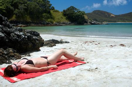 aotearoa: Girl in Bikini on Matai bay in Northland, New Zealand.