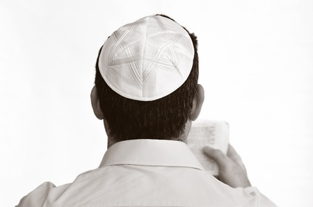 sephardi: Jewish man with kippah pray isolated on white background. Concept photo Judaism ,religion belief, faith, lifestyle