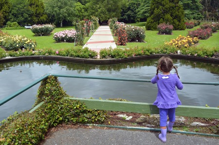 new age: Little girl (age 05) visit in the Rose Garden of Palmerston North, North Island, New Zealand. Stock Photo