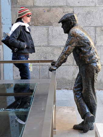 spanish woman: Spanish woman and a street statue in Madrid Spain.