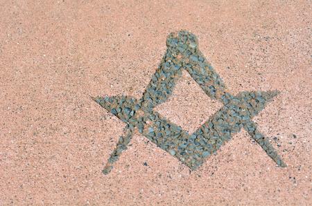 freemasonry: Freemasonry symbol made from stones on the ground.