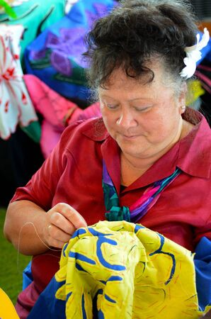 islander: Pacific islander woman sewing a Tivaevae.