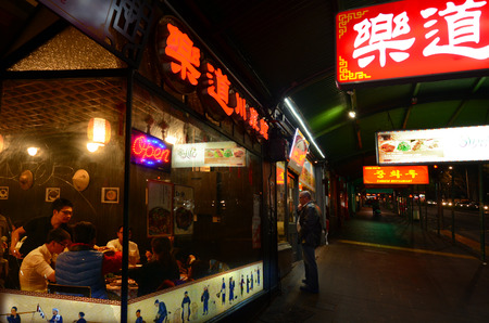 ethnically diverse: AUCKLAND - SEP 28 2015: Asian restaurants on Queen street in Auckland New Zealand. Auckland is the most ethnically diverse region in New Zealand with about 20 percent identifying as Asian descent.