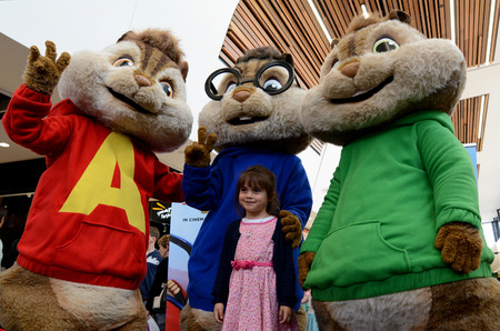 scheduled: AUCKLAND - SEP 02 2015:Little girl (Talya Ben-Ari age 05) photo with The Chipmunks.The new film Alvin and the Chipmunks: The Road Chip is scheduled to be released in theatres on December 23, 2015.