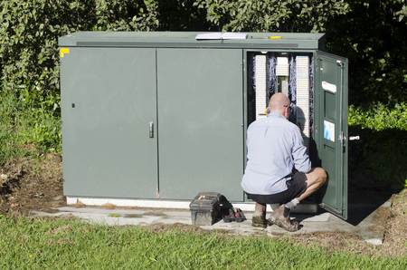maintains: TAIPA, NZ - MAY 09:Chorus service technicians maintains the Network on May 09 2013.Chorus is New Zealands largest telecommunications infrastructure company. Editorial