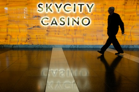 nz: AUCKLAND, NZ - MAY 29:Person visits in Skycity casino - Auckland on May 29 2013.1.5 of the casino operating profit has to be paid out to charity according to the NZ law.
