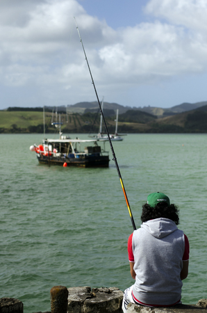 nz: MANGONUI, NZ - APRIL 17:Fisherman fishing on April 17 2013 Mangonui, New Zealand.NZ exclusive economic zone covers 4.1 million km2,Its the 6th largest zone in the world and 14 times the size of NZ. Editorial