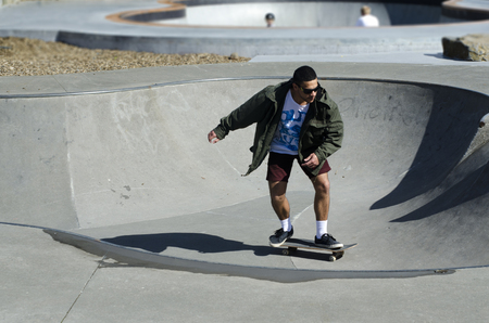 nz: AUCKLAND, NZ - APRIL 25:Young man Skateboarding on April 25 2013 in Auckland, New Zealand.Today, there are more than 100 million skaters across the world.