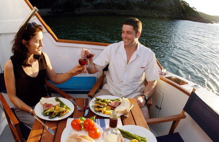 nz: KERIKERI,NZ - DEC 10:Romantic couple having dinner on a yacht on Dec 10 2004.The Marriage rates in NZ have fallen in the past 40 years and a record low 20,900 marriages took place in 2011.