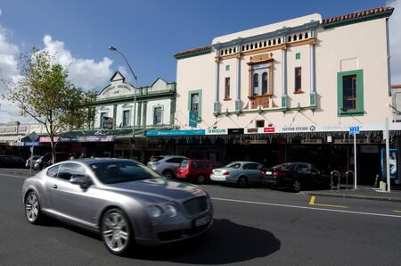 upmarket: AUCKLAND, NZ - MAY 27:Traffic on ponsonby road on May 30 2013.Its known for its vibrant restaurants, cafes, art galleries, up-market shops and nightclubs Editorial