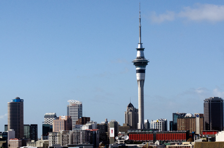 compared: AUCKLAND, NZ - MAY 27:Auckland Sky Tower on May 27 2013. Due to its shape and height, especially when compared to the next tallest structures, it has become an iconic structure in Aucklands skyline.