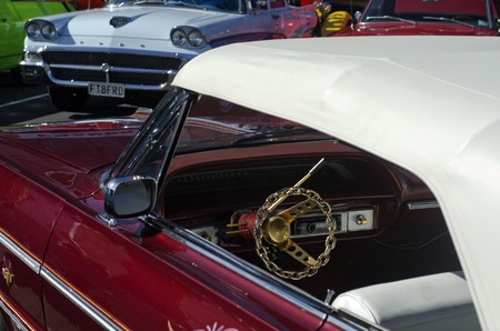 nz: AUCKLAND, NZ - APRIL 25:Golden steering wheel of a 59 Cadillac on April 25 2013 in Auckland, New Zealand.In NZ there are more then 13,000 vintage classic cars in immaculate condition.