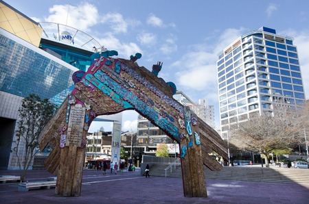 expressionist: AUCKLAND - MAY 29:Waharoa(Gateway in Maori)arch in Aotea Square on May 29 2013. This is an expressionist version of a traditional Māori entry gate formed in wood and copper by sculptor Selwyn Muru. Editorial