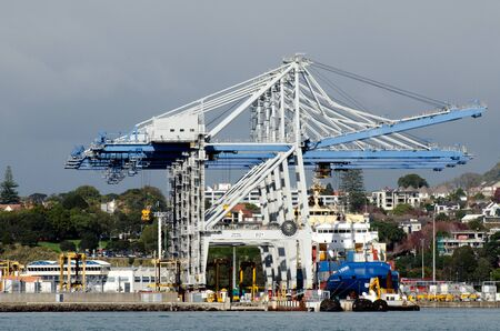 billion: AUCKLAND,NZ - MAY 29:Cargo ship and container cranes on Fergusson Wharf at Ports of Auckland on May 29 2013.Its New Zealands largest commercial port, its turnover of more than NZ$20 billion per year Editorial