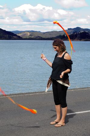 practiced: MANGONUI, NZ - APRIL 06: Woman perform Poi on April 06 2013 in Mangonui water front festival, New Zealand.Poi originated with the Māori people of New Zealand thousands of years ago, where it is still practiced today. Editorial