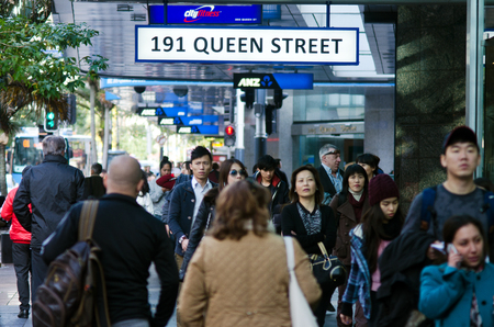 expected: AUCKLAND - MAY 29:Asian people in Queen street on May 29 2013.In 2011, of every 100 Aucklanders, 22 of them are of Asian decent and by 2021, Auckland is expected to have 27% people of Asian decent.