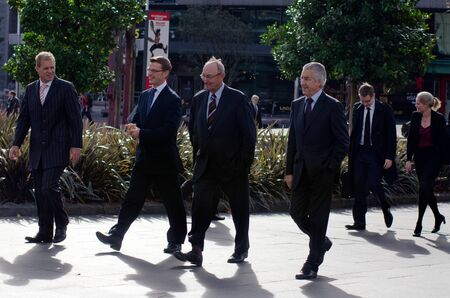 nz: AUCKLAND, NZ - MAY 27:Businessmen on Queen Street on May 27 2013. 36% of NZ men working full-time worked 50 or more hours.