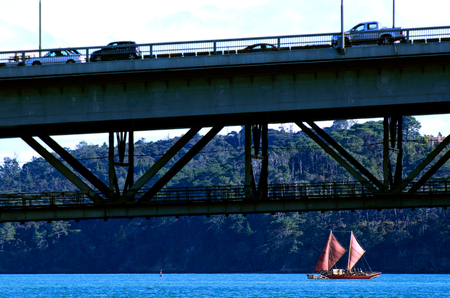revive: AUCKLAND,NZ - JUNE 02:Te Aurere (Maori double-hull canoe) sail under Auckland Harbour Bridge  on May 30 2013.Built in 1991-2 to help revive the Māori culture of ocean sailing it has sailed 30,000 NM. Editorial