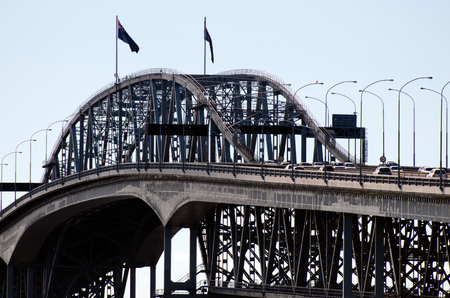 presently: AUCKLAND,NZ - JUNE 02:Traffic on Auckland Harbour Bridge on June 02 2013.The daily average number of cars crossing the Auckland Harbour Bridge is presently around 165,000 Editorial