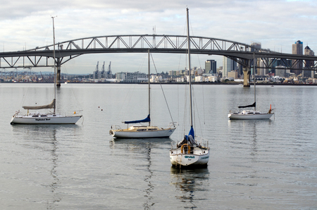 span: AUCKLAND,NZ - JUNE 02:Boats mooring near Auckland Harbour Bridge on May 30 2013.It has a length of 1,020 m (3,348 ft), with a main span of 243.8 m, rising 43.27 m above high water