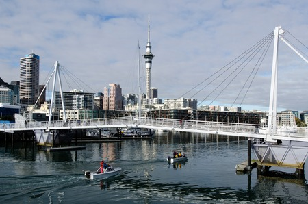 AUCKLAND - JUNE 02:Motor boats pass under Wynyard Crossing on June 02 2013.Its a new double bascule walking  cycling bridge built in 2011 in Auckland, New Zealand.