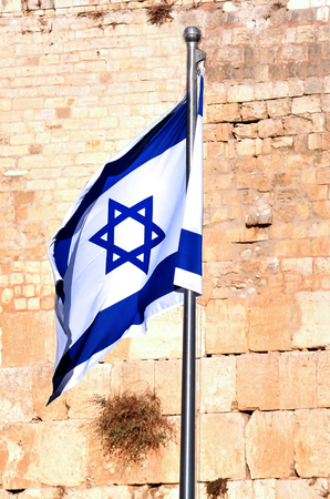 kotel: JERUSALEM - NOV 12:Israel flag at the Western Wall on Nov 12 2008.Its a remnant of the the Jewish Temples and the most sacred site recognized by the Jewish faith outside of the Temple Mount itself.